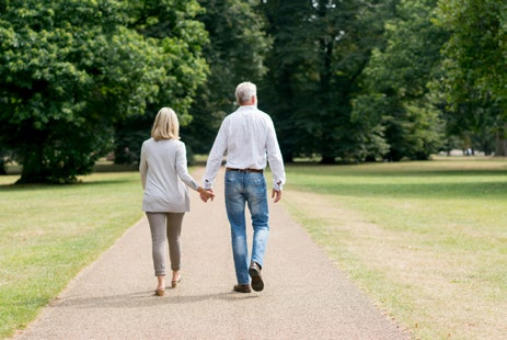 Couple going for walk in park